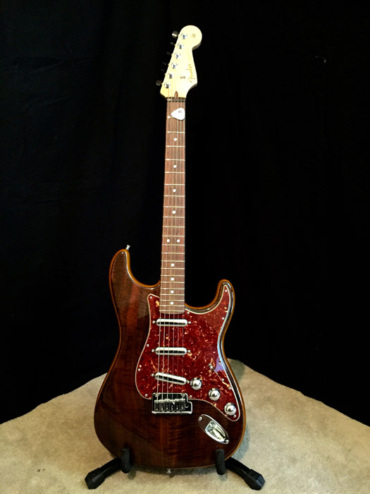 2014 Fender Custom Shop Walnut-Top Artisan Stratocaster : This was one of those guitars I stumbled across and couldn't take eyes off of. The walnut top with the buckeye alder wood is incredible to see. I plugged it in and loved the 70's feel the neck. The custom lipstick pickup have a 50's snap for the lead tone with full, fat rhythm chords. Chrome hardware and ebony wood tuning knobs make this a piece of art that is a blast to play.